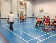 Hepburns officiating a match in the Wheelchair Basketball Outreach Programme